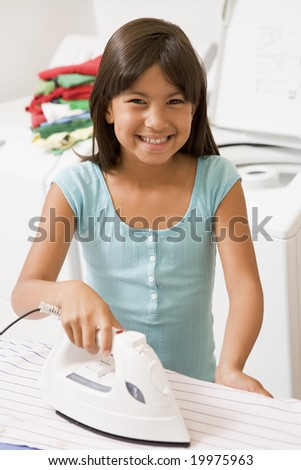 Young Girl Ironing - stock photo