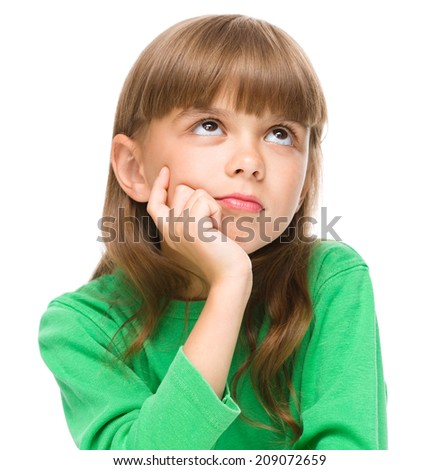Young girl is daydreaming while sitting at table, isolated over white - stock photo