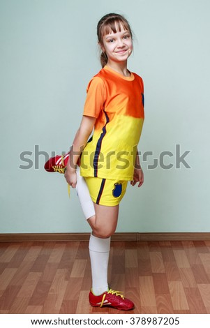 Young girl is doing stretching exercises for legs - stock photo