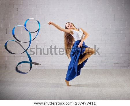 One caucasian woman exercising rhythmic gymnastics with ribbon in - Gymnastics Ribbon Stock Photos Images Amp Pictures