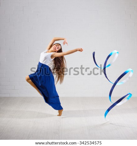 Young girl is engaged in art gymnastics - stock photo