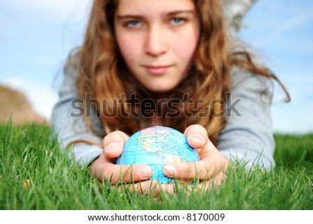 young girl is enjoying herself at outdoor location - stock photo