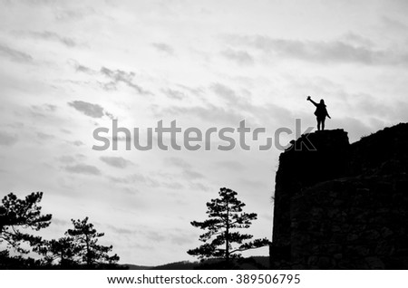 Young girl is enjoyng life during calm sunset - black and white photo - stock photo