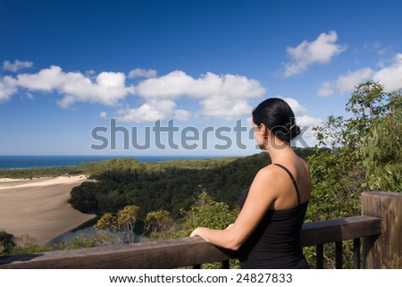 Young girl is looking at the ocean, Fraser Island, Australia - stock photo