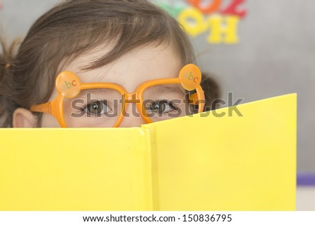 Young girl is ready to go back to school. - stock photo