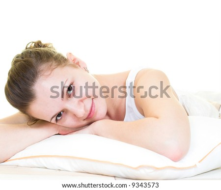 Young girl is relaxing in the bed. Isolated.