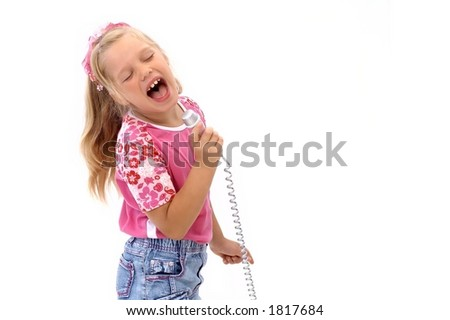 Young girl is singing with a microphone - stock photo