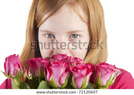 young girl is smelling at beautiful pink roses on a white background - stock photo