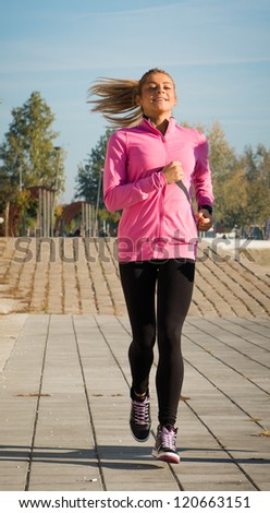 young girl jogging outdoor in morning - stock photo