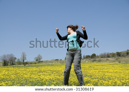 Young girl jump in field