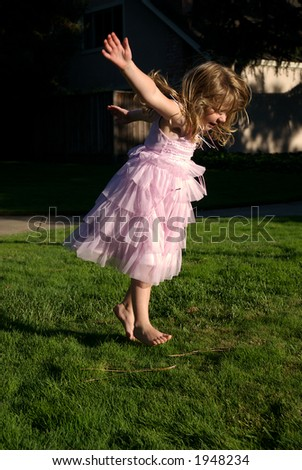 young girl jumping and dancing - stock photo