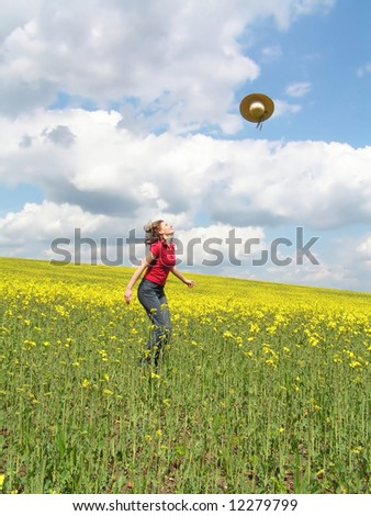 Young girl jumping in rapeseed field