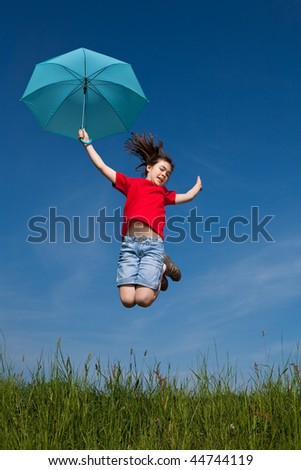 Young girl jumping outdoor against blue sky
