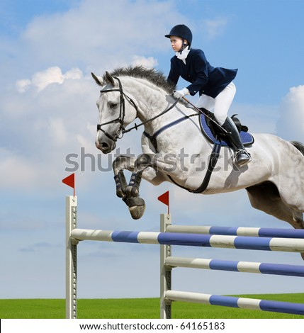 Young girl jumping with grey horse - stock photo