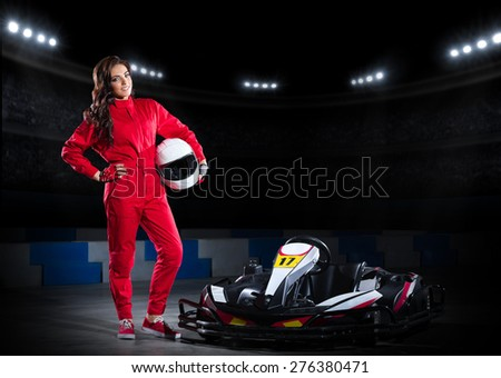 Young girl karting driver at sports hall - stock photo