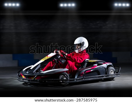 Young girl karting racer at stadium - stock photo