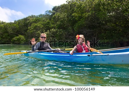 Young Girl Kayaking in tropical mangroves - stock photo