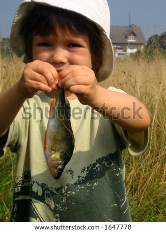 young girl keeping bass (Perca fluviatilis) - stock photo