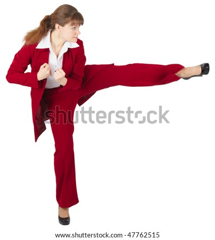 Young girl kicks, isolated on a white background