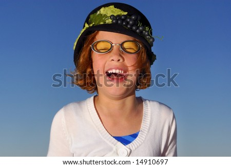 Young girl laughing during a photo shoot - stock photo