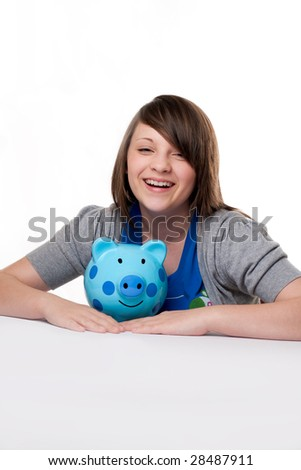 young girl laughing with blue spotted biggy bank isolated on white background
