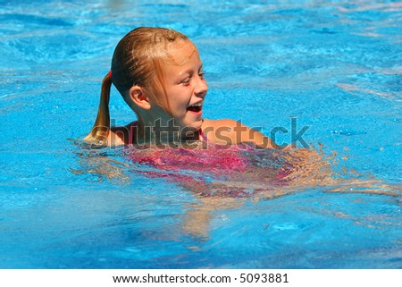 Young Girl Laughs in Swimming Pool - stock photo