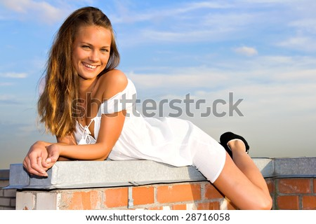 young girl lay on the roof of a skyscraper