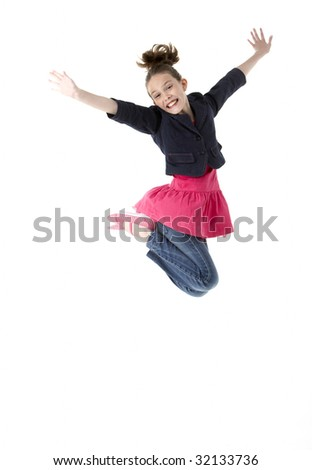 Young Girl Leaping In Air - stock photo