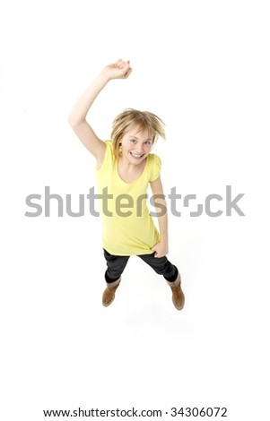 Young Girl Leaping In Studio - stock photo