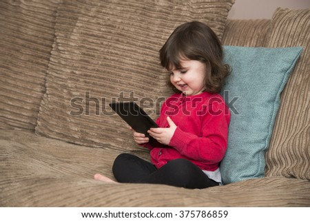 Young girl learning by watch shows Tablet - stock photo