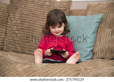 Young girl learning on her tablet - stock photo