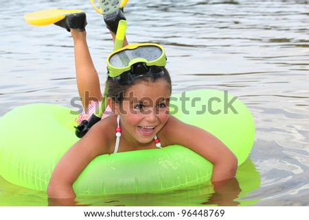 Young girl learning to snorkel - stock photo