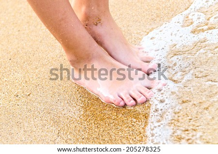 young girl legs in sea