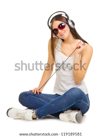 Young girl listen music by headphones isolated - stock photo