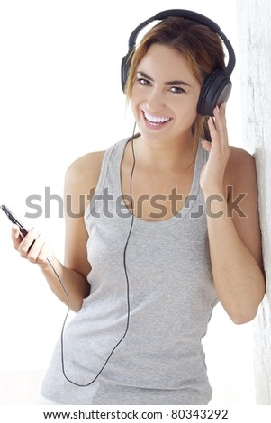 young girl listening music - stock photo
