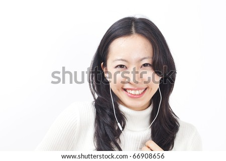 young girl listening to music - stock photo