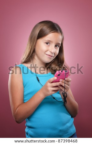 Young Girl Listening to Music on Cell Phone - stock photo