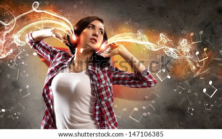 Young girl listens to music. Modulations of color and light. - stock photo