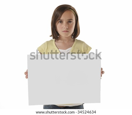young girl looking at camera holding a blank panel in front of her body on white background