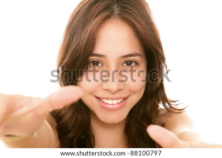Young girl looking at the camera over white background - stock photo