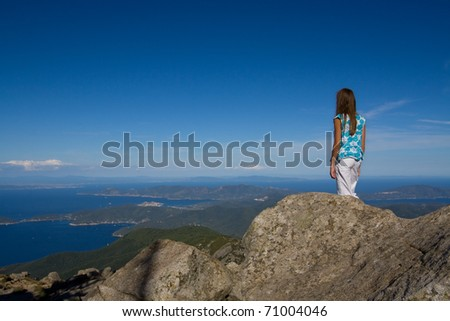 Young girl looking at the island view