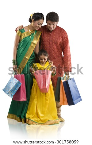 Young girl looking inside a shopping bag