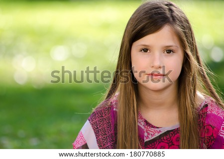 Young Girl Looking Into Camera  - stock photo