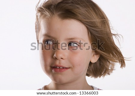 Young Girl Looking Off Camera with the Wind in her Hair