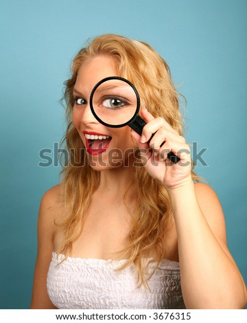 Young Girl Looking Through the Magnifying Glass - stock photo