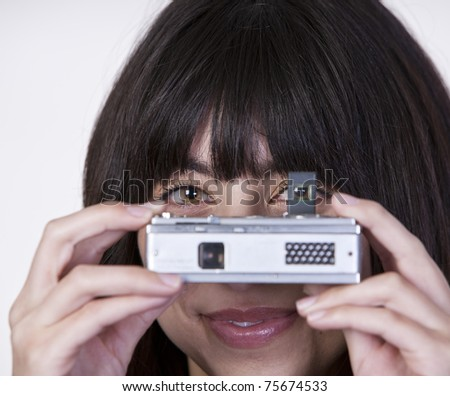 Young Girl Looking Through Vintage Camera