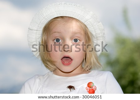 Young girl looks frightened into the camera - stock photo