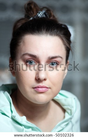 young girl looks into the camera lens - stock photo