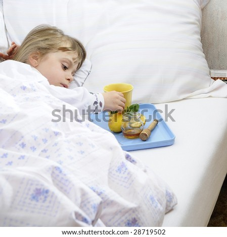Young girl lying in bed with flu - stock photo