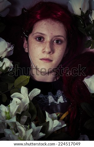 young girl lying in water, romantic scene - stock photo